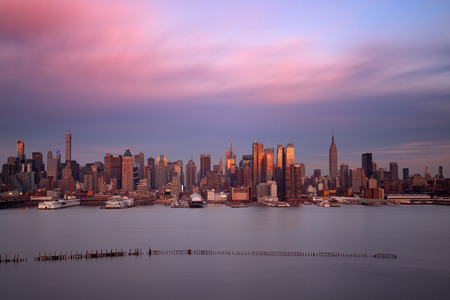 hudson river: Midtown skyline over Hudson River in New York City with skyscrapers at sunset