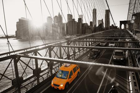 black cab: Brooklyn Bridge with traffic in downtown Manhattan New York City