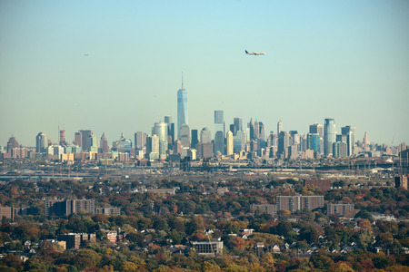 wtc: New York City skyline with airplane viewed from park with Autumn foliage Stock Photo