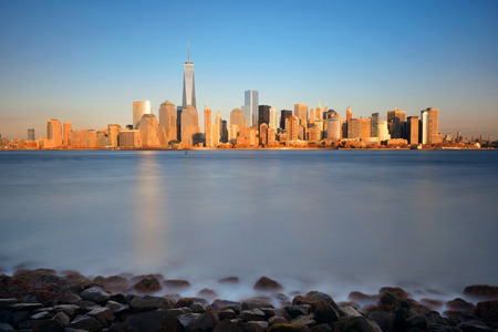 hudson river: New York City skyline with skyscrapers over Hudson River at sunset viewed from New Jersey Stock Photo
