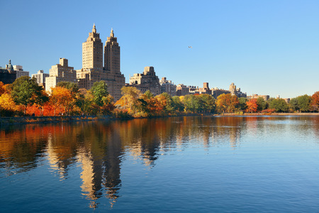 Skyline with apartment skyscrapers over lake in Central Park in midtown Manhattan in New York City Stock Photo
