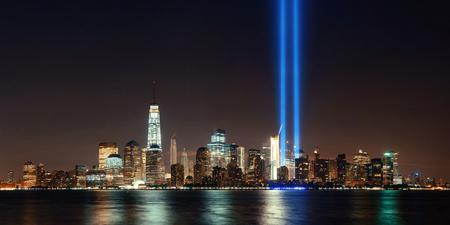 New York City downtown skyline at night panorama over Hudson River and September 11 tribute light Standard-Bild