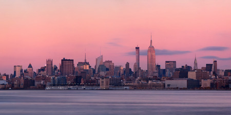 hudson river: New York City midtown skyline with skyscrapers over Hudson River viewed from New Jersey at sunset Stock Photo