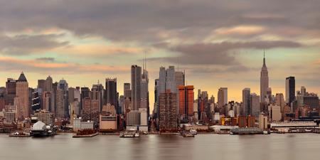 sunset city: Manhattan midtown skyscrapers and New York City skyline at sunset Stock Photo