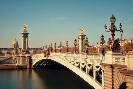Alexandre III bridge and Napoleon tomb in Paris, France. Stock Photo