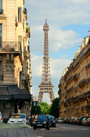 traffic building: PARIS, FRANCE - MAY 13: Eiffel Tower and street view on May 13, 2015 in Paris. With the population of 2M, Paris is the capital and most-populous city of France Editorial