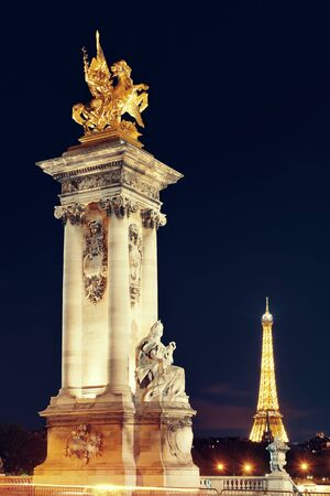alexandre: Alexandre III bridge statue over River Seine at night in Paris, France.