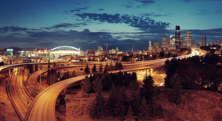 light trail: Seattle city view with urban architecture and traffic light trail.