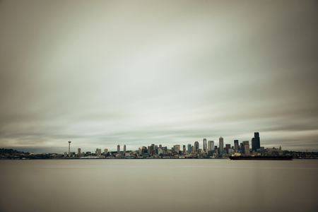 sea view: Seattle city skyline view over sea with urban architecture.