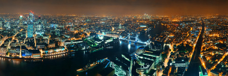illuminating: London aerial view panorama at night with urban architectures and tower bridge.