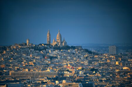 coeur: Paris city skyline rooftop view and Sacre Coeur cathedral at sunset, France.