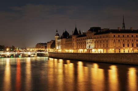 night dusk: River Seine and bridge at night in Paris, France.