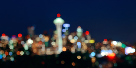 city park skyline: Seattle city skyline bokeh at night with urban office buildings viewed from Kerry Park.