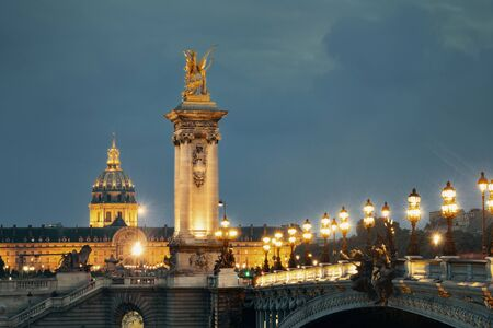 napoleon iii: Alexandre III bridge night view with Napoleons tomb in Paris, France. Stock Photo