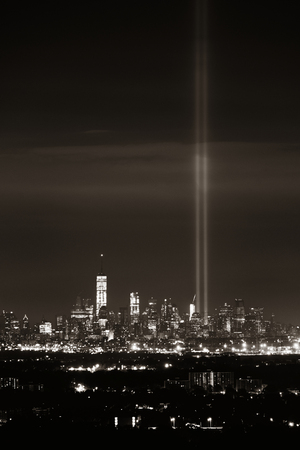tribute: New York City skyline at night and September 11 tribute light Stock Photo