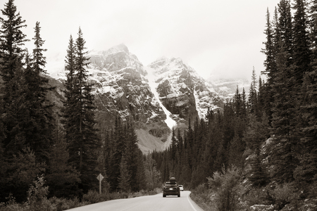 capped: Snow capped mountain of Banff National Park and highway in Canada Stock Photo