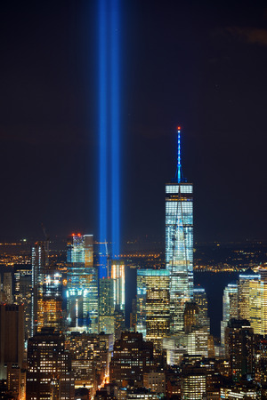 11: New York City downtown skyline view at night with September 11 tribute light. Stock Photo