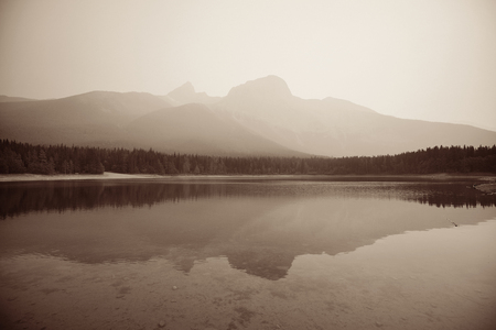 fog white: Lake with fog and mountain reflections
