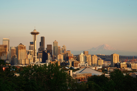 city park skyline: Seattle city skyline with Mt Rainier at sunset with urban office buildings viewed from Kerry Park.