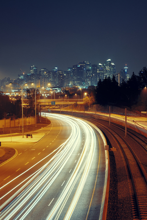 Calgary downtown with light trails at night, Canada. Stock Photo