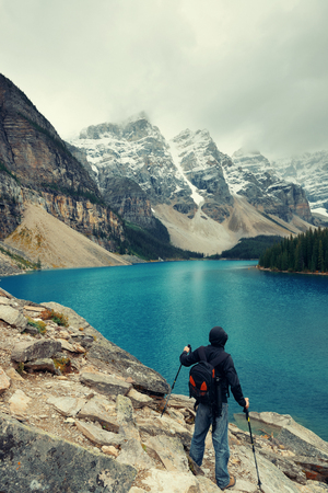 banff national park: Hiker in Moraine Lake with snow capped mountain of Banff National Park in Canada