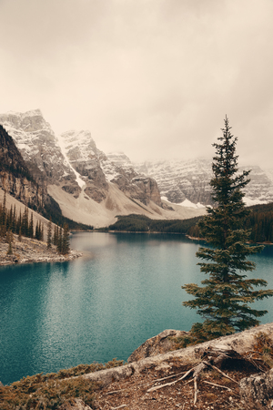 banff national park: Moraine Lake with snow capped mountain of Banff National Park in Canada