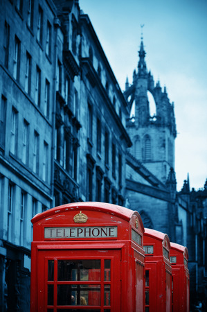 giles: Edinburgh city street view with telephone box in United Kingdom. Stock Photo