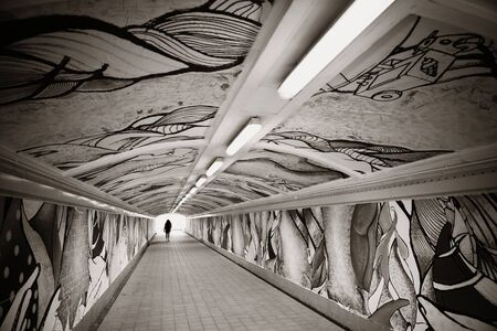 Singapore urban pedestrian tunnel with art painting