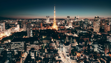 Tokyo Tower and urban skyline rooftop view at night, Japan.