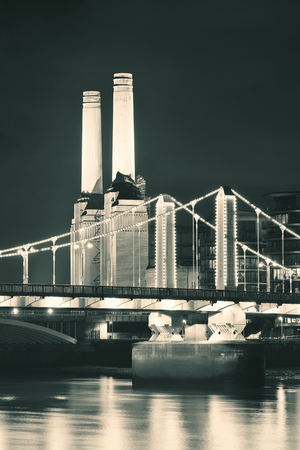 battersea: Battersea Power Station over Thames river as the famous London landmark at night.