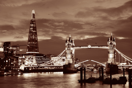 shard: The Shard and Tower Bridge over Thames River in London at dusk. Stock Photo