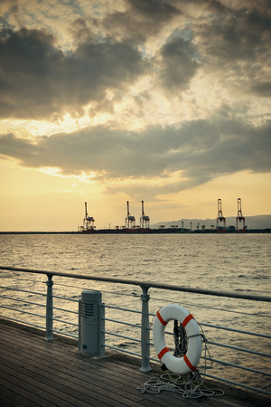 sea seaport: Osaka seaport with crane silhouette at sunset. Japan. Stock Photo