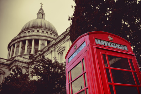 telephone booth: Red telephone booth and St Pauls Cathedral in London. Stock Photo