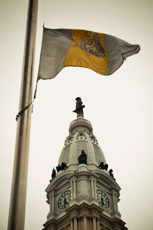 history building: Philadelphia flag and city Hall