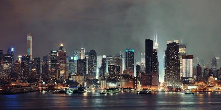Manhattan panorama midtown skyscrapers and New York City skyline at night with fog