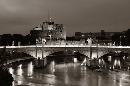 castel: Castel Sant Angelo in Italy Rome at night over Tiber River with reflection Stock Photo