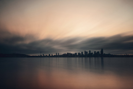 view on sea: Seattle city skyline view over sea with urban architecture.