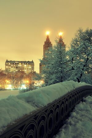winter park: Central Park winter with skyscrapers and Bow Bridge in midtown Manhattan New York City