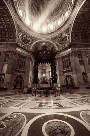 St. Peters Basilica interior with light beam in Vatican City.