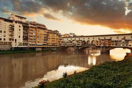 ponte vecchio: Ponte Vecchio over Arno River in Florence Italy at sunrise Stock Photo