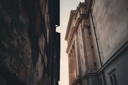 emmanuel: Alley with old buildings and National Monument to Victor Emmanuel II in Rome, Italy. Stock Photo