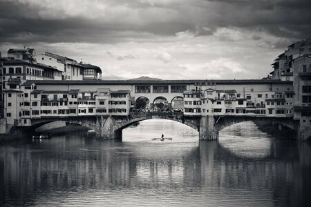 ponte vecchio: Ponte Vecchio over Arno River in Florence Italy black and white. Stock Photo