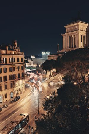 emmanuel: Street view at night with National Monument to Victor Emmanuel II in Rome, Italy.