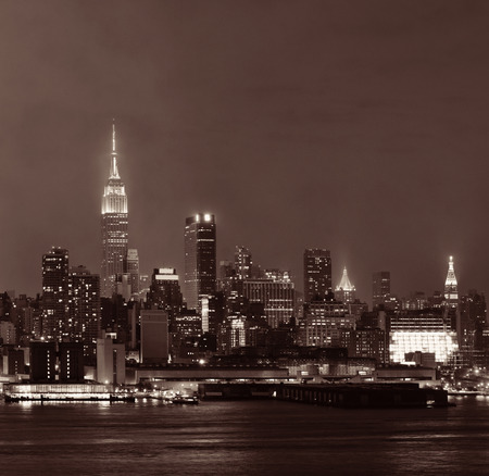 Manhattan midtown skyscrapers and New York City skyline at night with fog Stock Photo