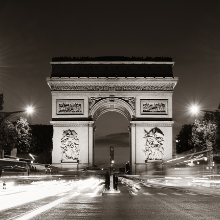 traffic building: Arc de Triomphe and street view at night in Paris, France.