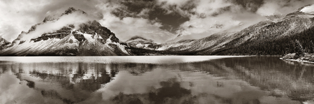 black forest: Bow Lake panorama reflection with snow capped mountain and forest in Banff National Park Stock Photo