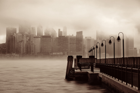 downtown district: New York City downtown business district with pier in a foggy day