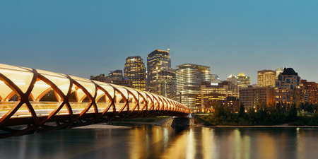 Calgary cityscape with Peace Bridge and downtown skyscrapers in Alberta at night, Canada. Stok Fotoğraf - 72160158