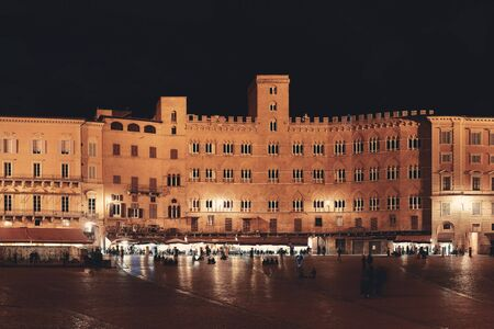 exterior shape: Old buildings in Piazza del Campo night view in Siena, Italy. Stock Photo