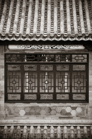 roof windows: Local Bai style architecture roof and window in Dali old town. Yunnan, China. Stock Photo